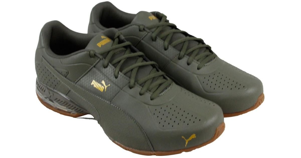 bd05a6bcd8e8b1 Lyst - PUMA Cell Surin 2 Premium Olive Night Gold Athletic Training Shoes  in Black for Men