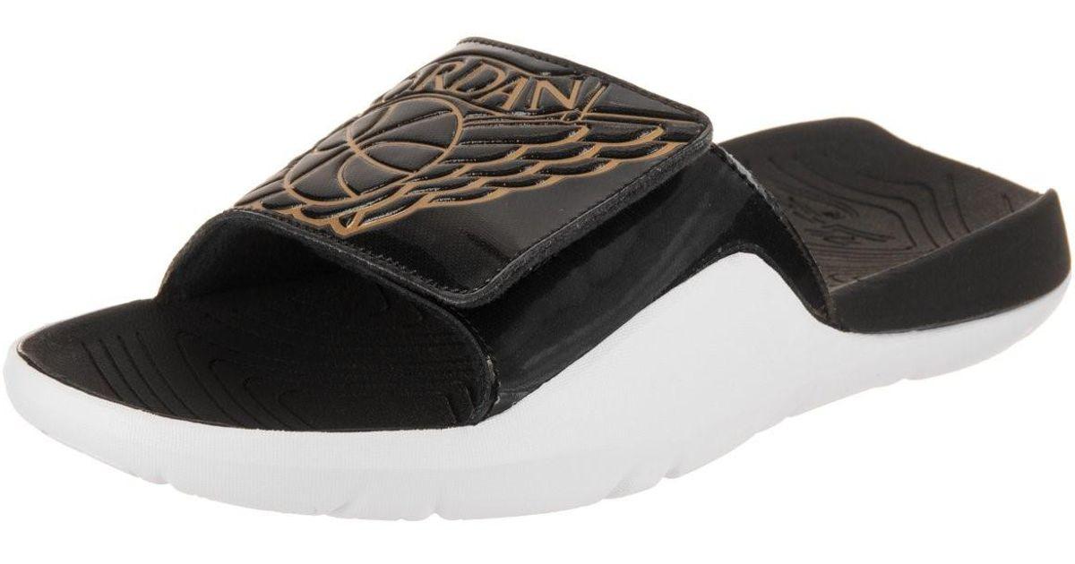 65a5ee28a60 Nike Nike Aa2517-021: Jordan Hydro V Ii Black/metallic Gold Sandals in  Metallic for Men - Lyst