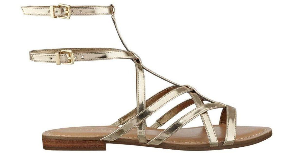 f4e6db4fa0af Lyst - Guess Mannie Gladiator Sandals in Metallic