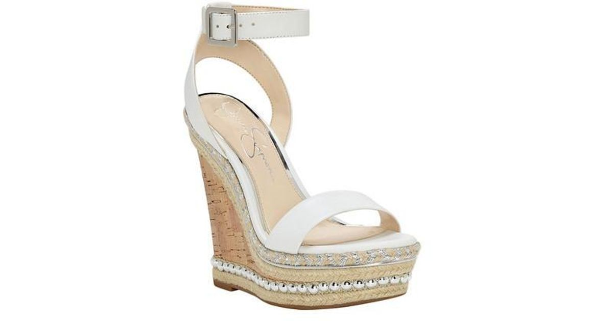 9261c4dbe7cb Lyst - Jessica Simpson Avey Wedge in White
