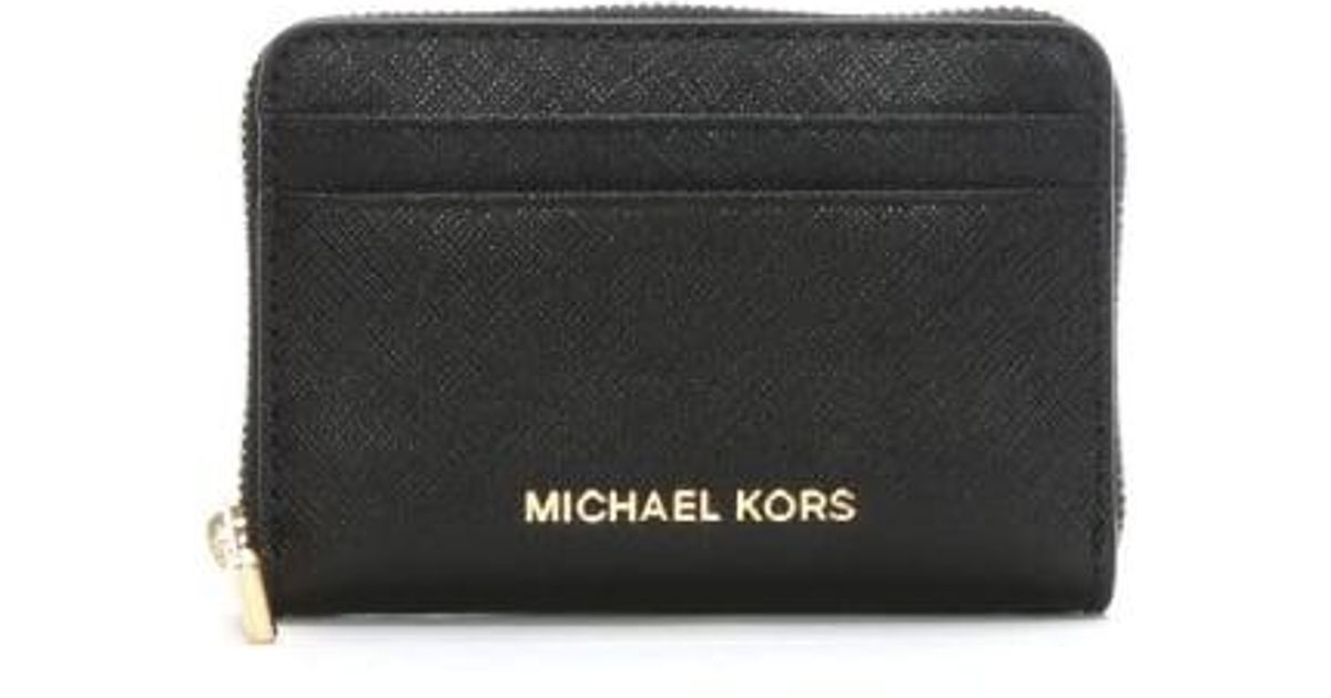 5a818280d50c31 Michael Kors Black Saffiano Leather Zip Around Card Case in Black - Lyst
