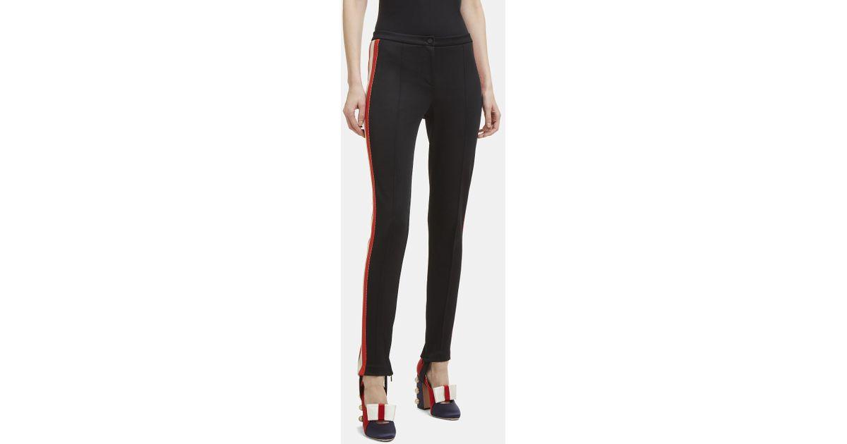 ea08e684892 Lyst - Gucci Striped Web Jersey Stirrup Logo Leggings In Black in Black