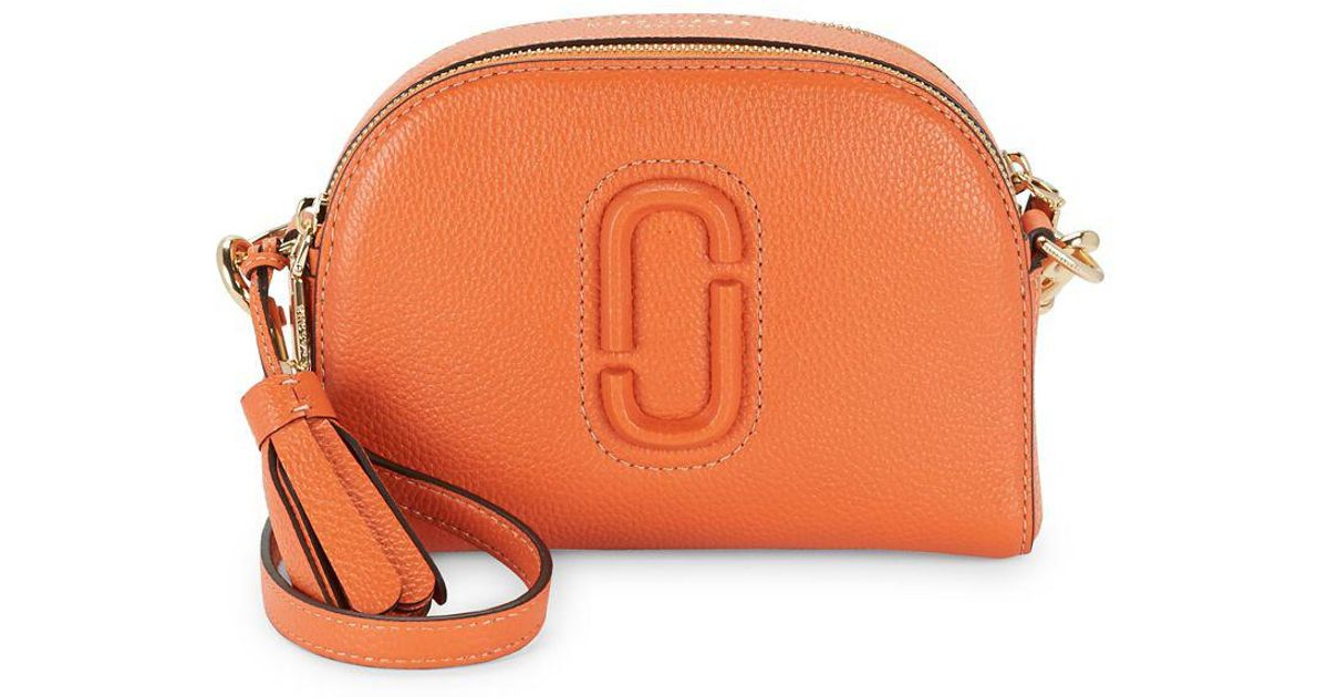 ab5984cf7a94 Marc Jacobs Shutter Leather Half Moon Crossbody Bag in Orange - Lyst