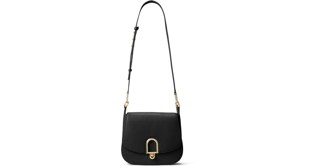 ff5f597d0c24 Lyst - Michael Michael Kors Delfina Leather Saddle Bag in Black