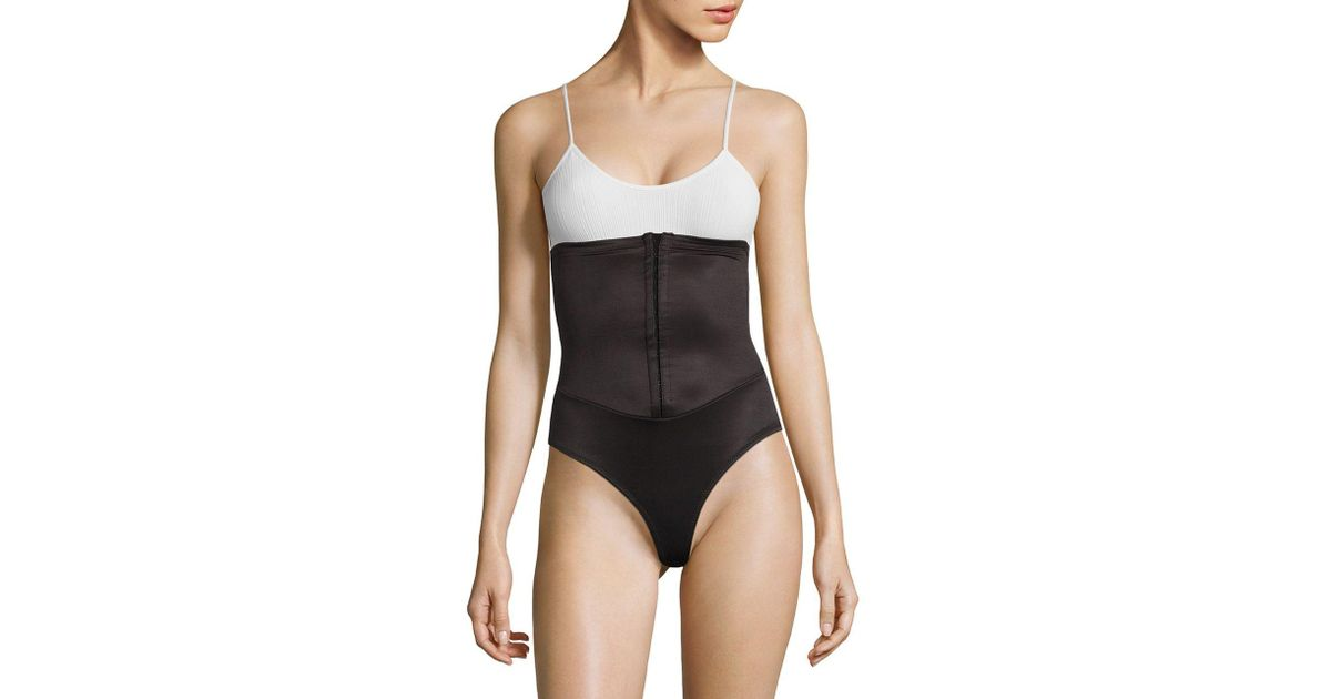 3369a63c16c13 Lyst - Miraclesuit Waist Cinching Thong Shaper in Black