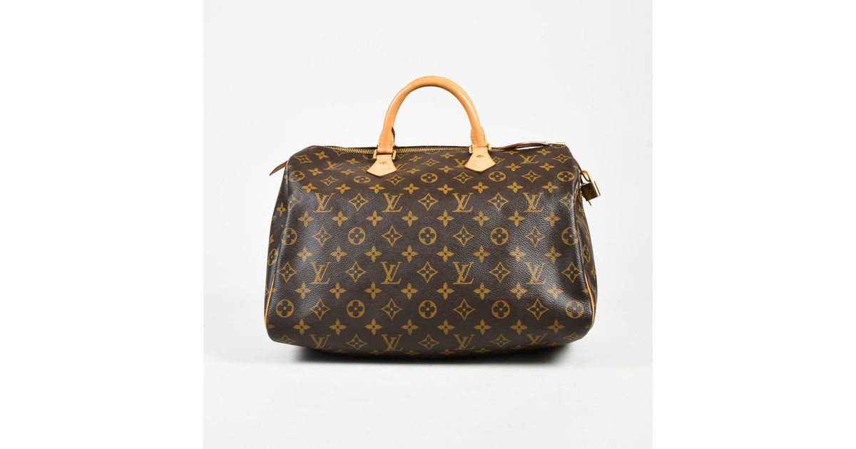 0eb50f30a8 Lyst - Louis Vuitton  990 Brown Monogram Coated Canvas