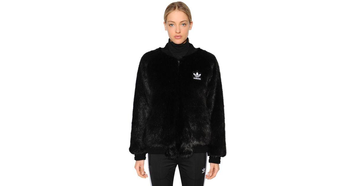 Lyst - adidas Originals Sst Faux Fur Bomber Jacket in Black 950019731f
