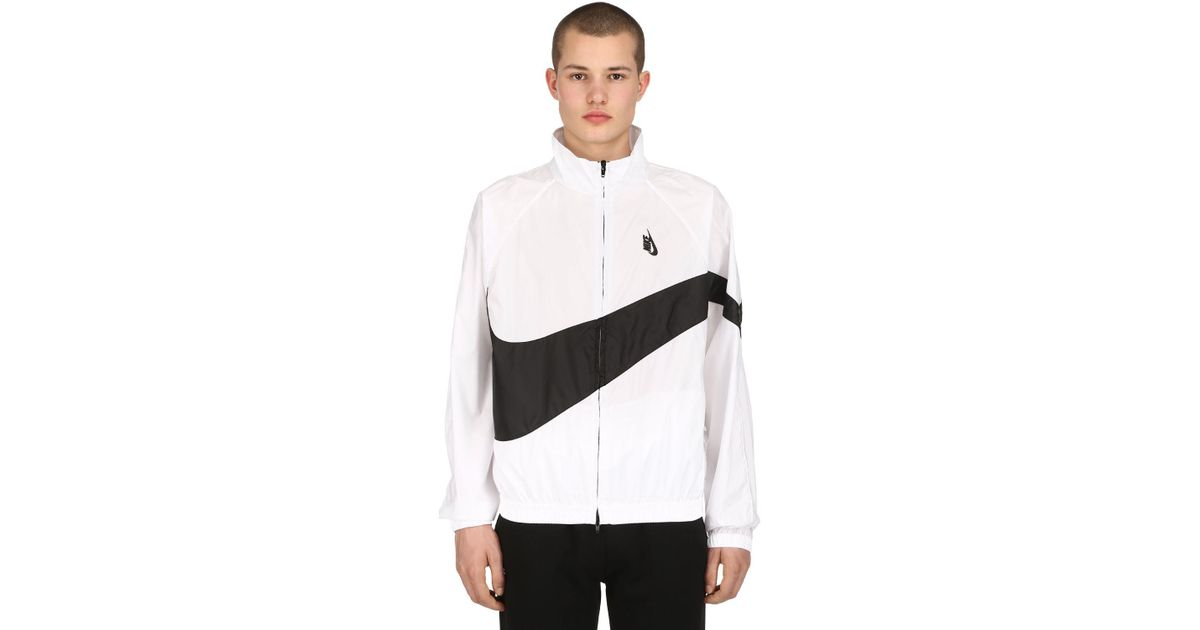 nouvelle arrivee 74346 12b3a Nike - White Veste de jogging