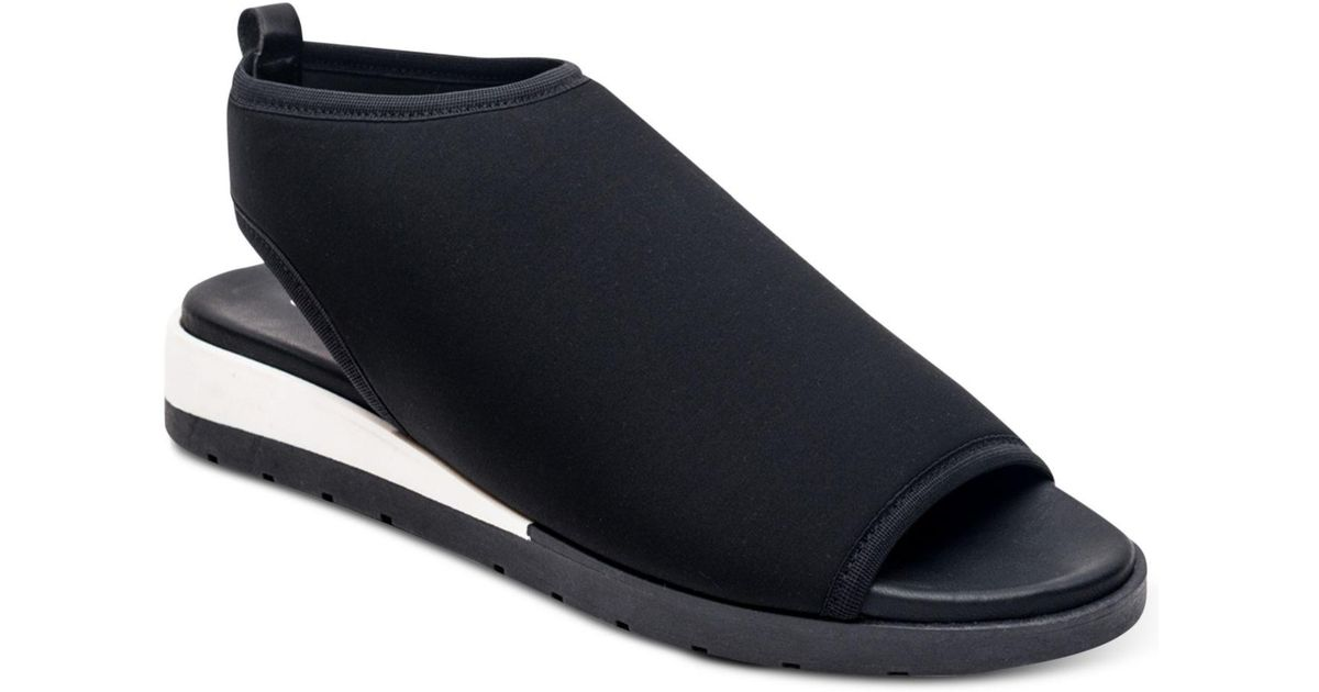 3167fbc8aa4e2f Lyst - Andre Assous April Slip-ons in Black