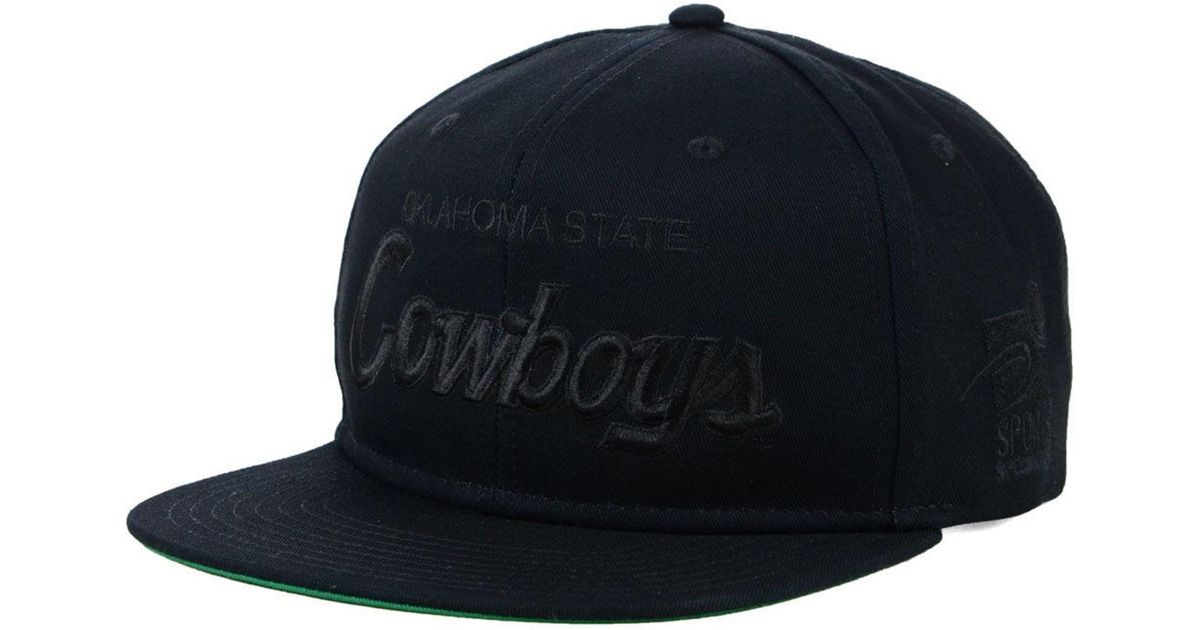 2af7486d8a41f ... cheap lyst nike oklahoma state cowboys sport specialties black on black  snapback cap in black for