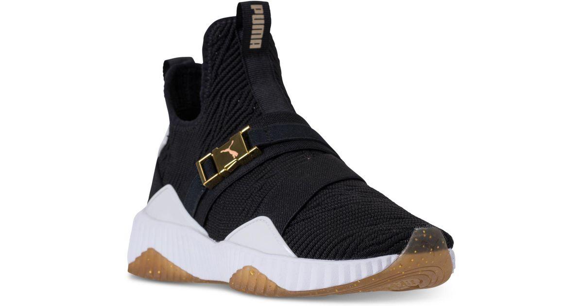 d0a90b3d9d51 PUMA - Black Women s Defy Mid Varsity Sneakers - Lyst