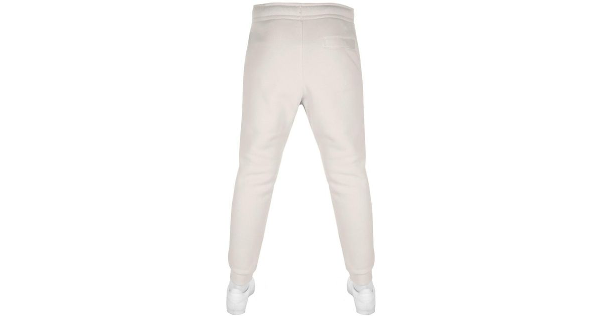 e17cb80d02bb Nike Tapered Fit Club Jogging Bottoms Beige in Natural for Men - Lyst