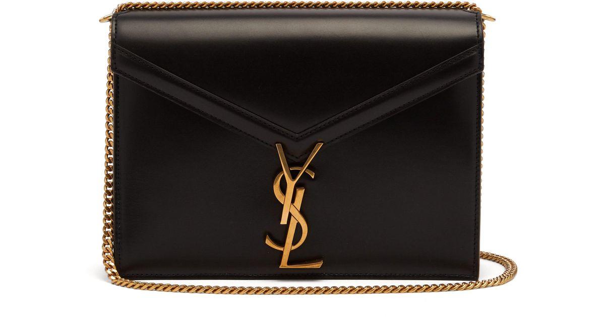 18fef943e93 Saint Laurent Cassandra Ysl Clasp Leather Cross Body Bag in Black - Lyst