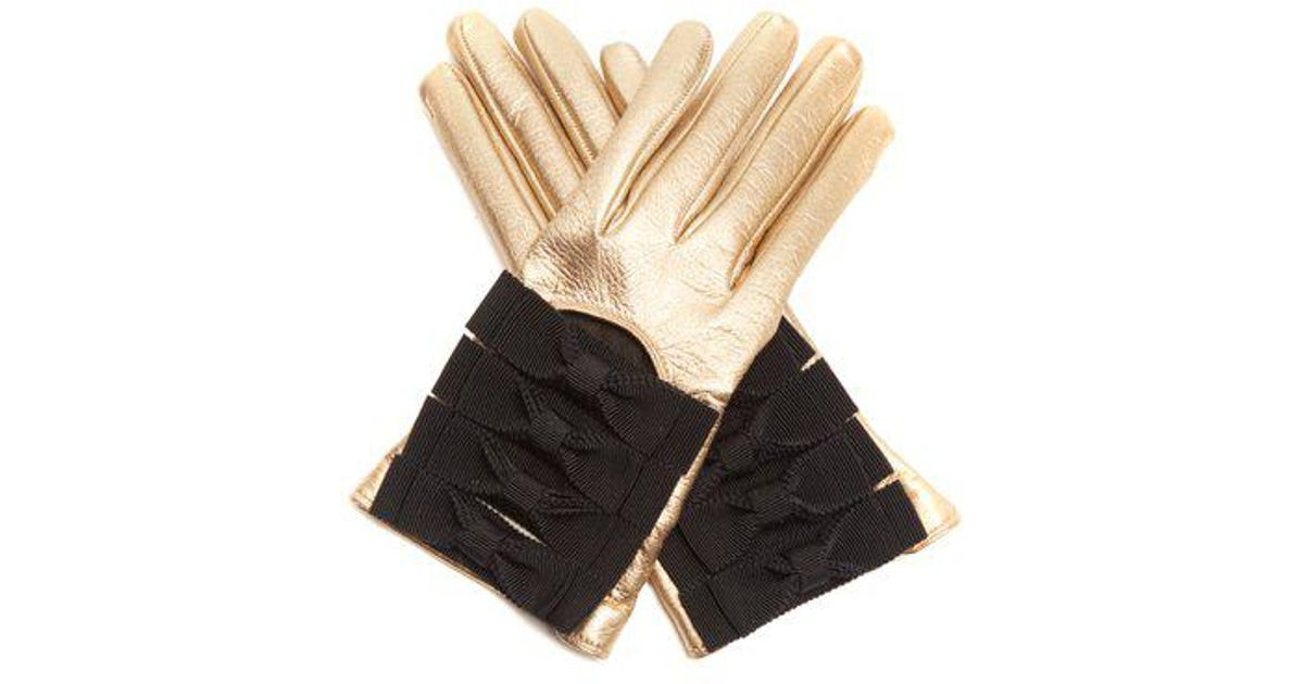 3e1dcecdf2d Lyst - Gucci Bow-detail Leather Gloves in Metallic