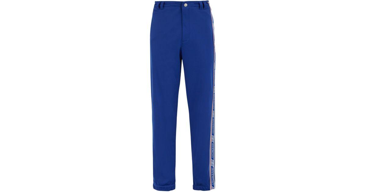 ffc6c954253 Lyst - Pantalon de jogging à bandes latérales logo Givenchy pour homme en  coloris Bleu - 50 % de réduction