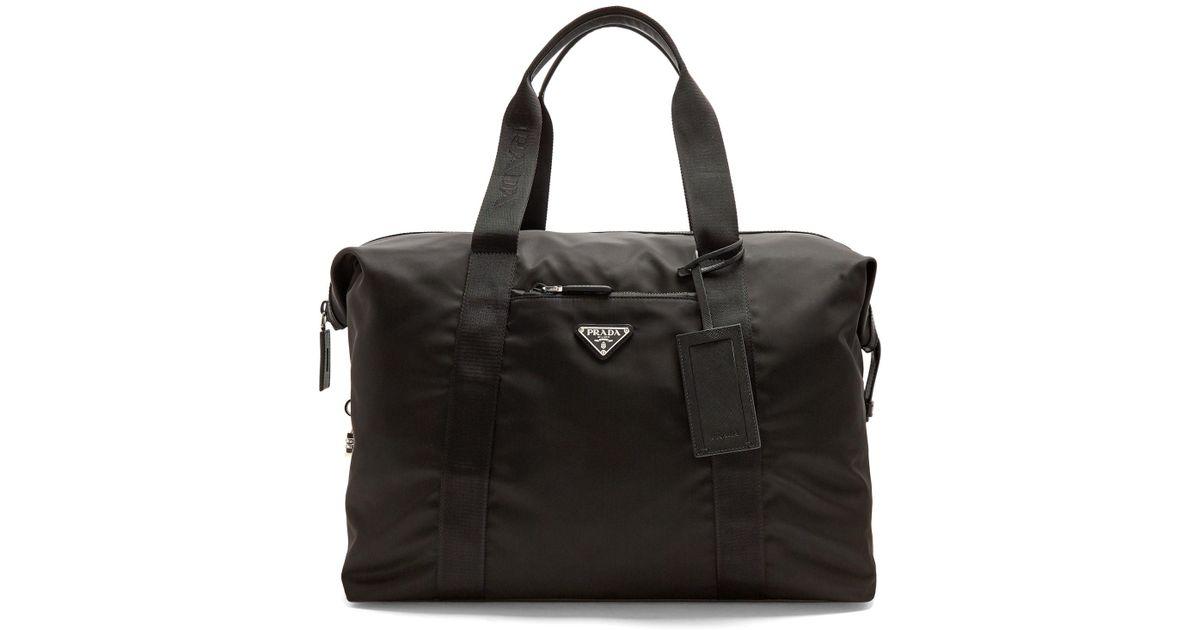7baecb3280 ... inexpensive lyst prada top handle nylon weekend bag in black for men  444e6 ae9e6