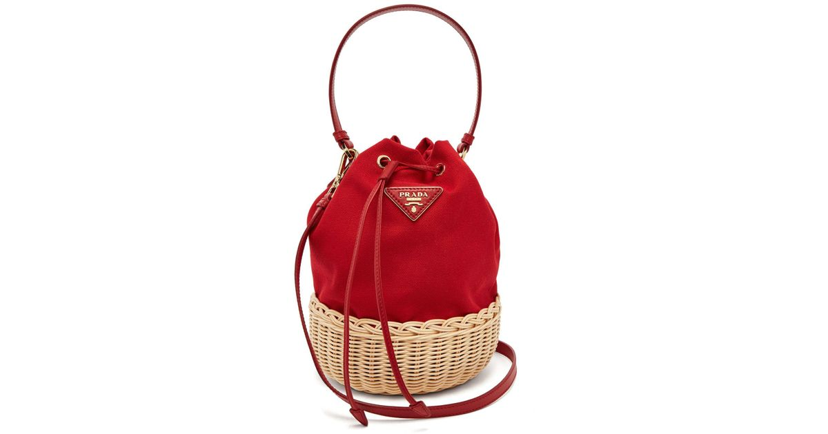 fd6f1148351a Lyst - Prada Canvas And Woven Straw Bucket Bag in Red