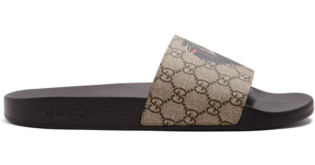ba693683101ce Lyst - Gucci Wolf-print Gg Supreme Slides for Men