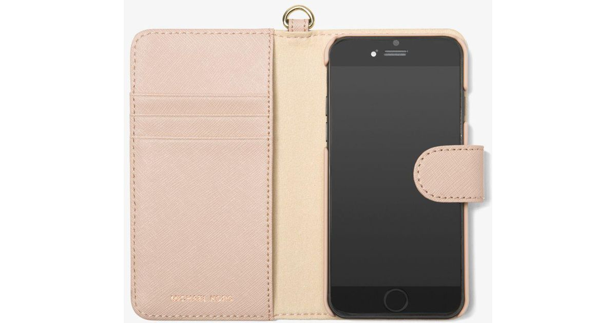 e8c7a089b612f Lyst - Michael Kors Perforated Leather Folio Phone Case For Iphone 7 in Pink