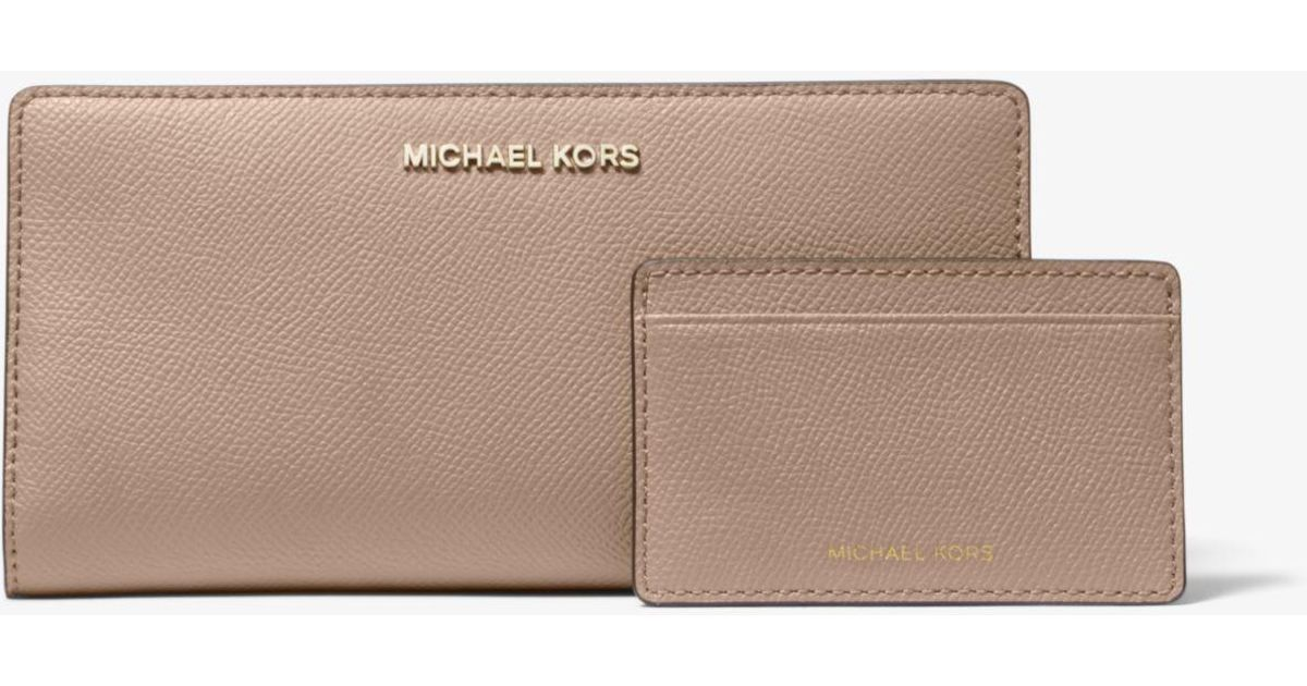 2ee568e99ac7ea Lyst Michael Kors Large Saffiano Leather Slim Wallet. Michael Kors Beige Jet  Set ...