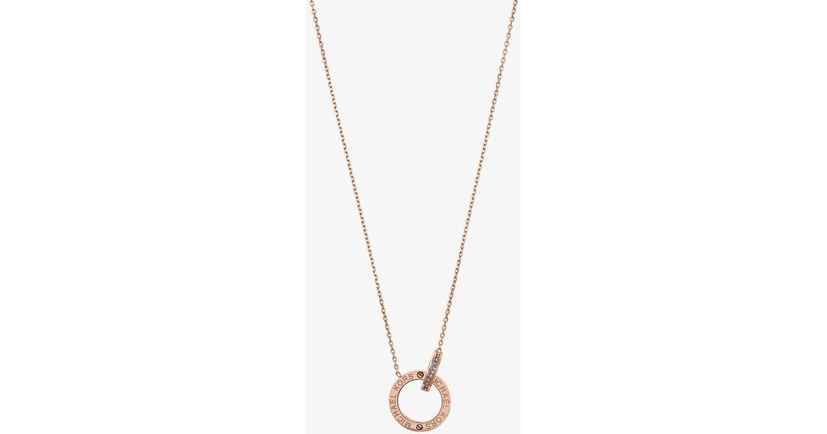 Lyst michael kors rose gold tone logo circle pendant necklace in lyst michael kors rose gold tone logo circle pendant necklace in metallic aloadofball Images