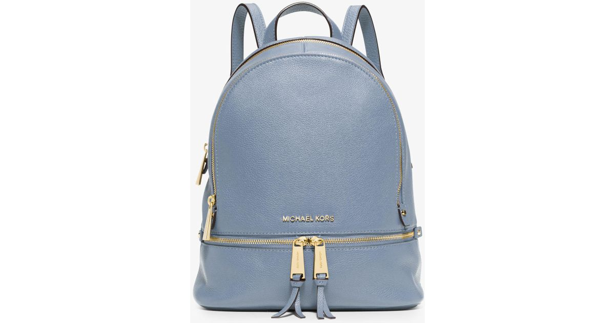 c2540805a1b9 ... denmark lyst michael kors rhea small leather backpack in blue a6917  f7b67 ...