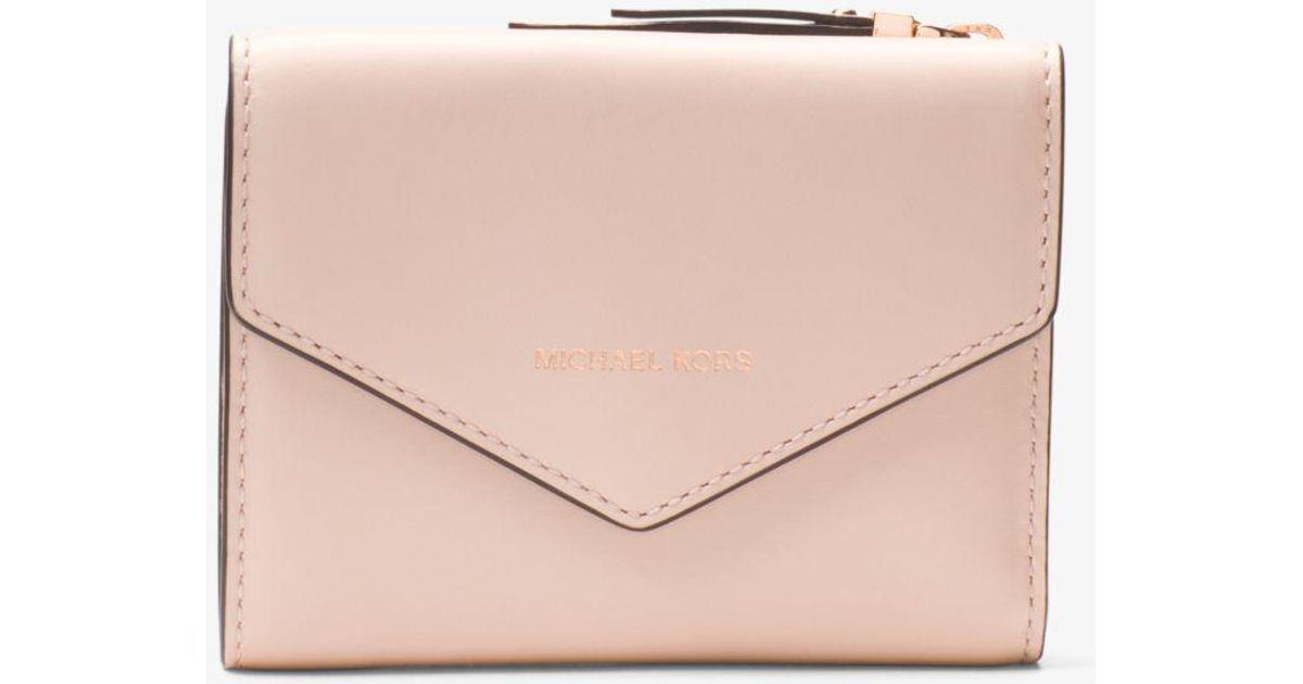 89b1dd4004a8 ... netherlands michael kors jet set small leather envelope wallet in pink  lyst 22584 dabc1 ...