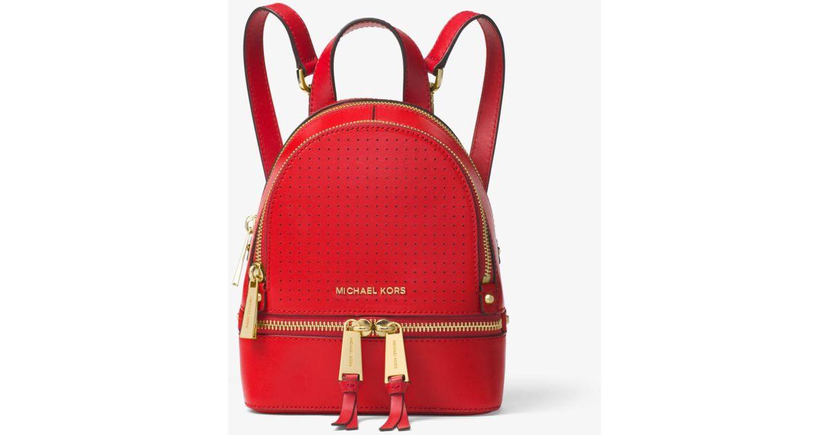 e38b6ddde72c Lyst - Michael Kors Rhea Mini Perforated Leather Backpack in Red