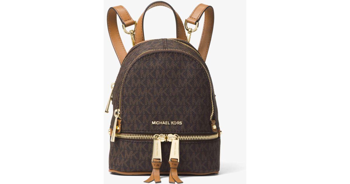 44cc4be3e23012 ... coupon code lyst michael kors rhea mini logo backpack in brown c8137  69beb