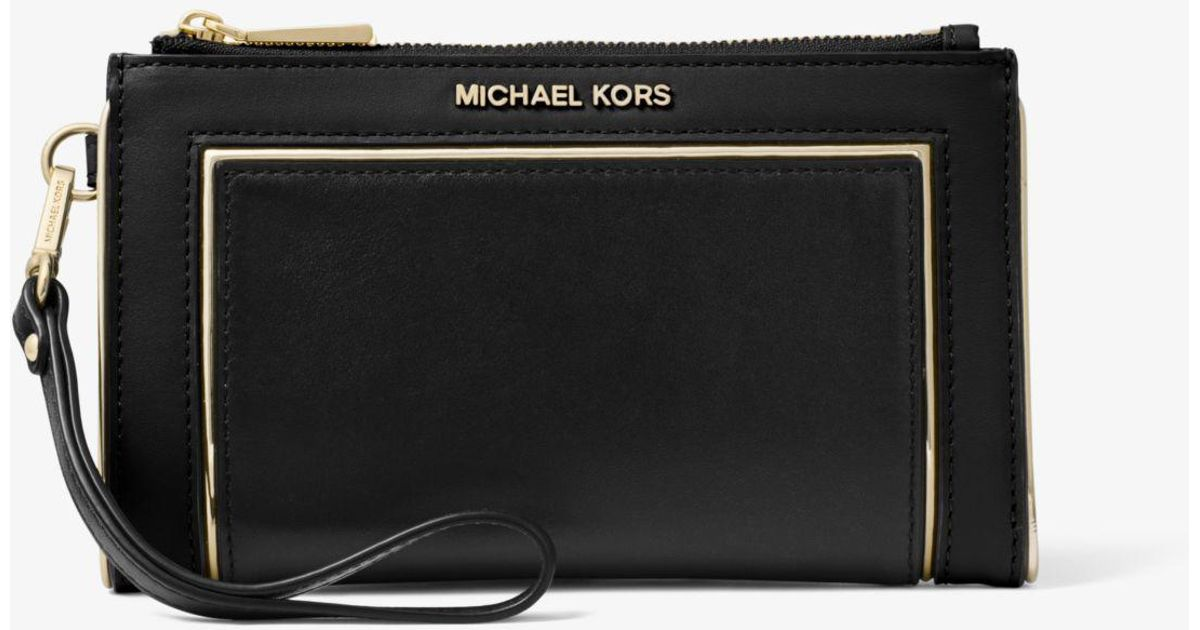 cd9c9ed008bc Lyst - Michael Kors Adele Framed Leather Smartphone Wallet in Black