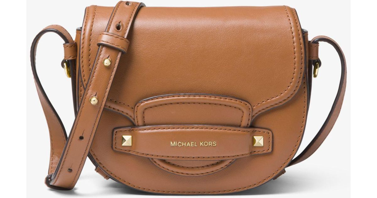 bfe3b3f8060c Lyst - Michael Kors Cary Small Leather Saddle Bag in Brown