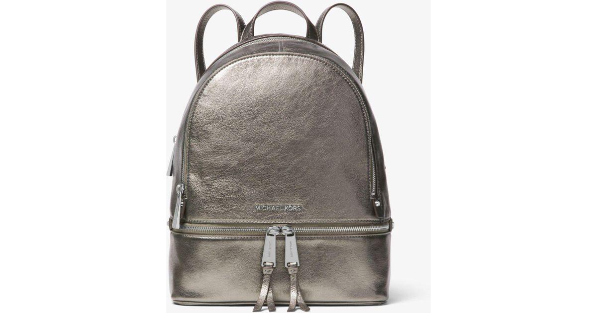 1efe707231e8 Lyst - Michael Kors Rhea Medium Metallic Leather Backpack