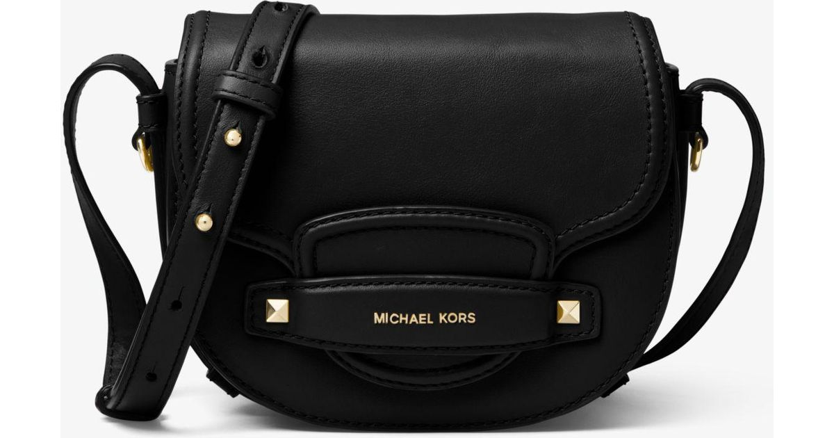 2ee64c4bb951 Michael Kors Cary Small Leather Saddle Bag in Black - Lyst