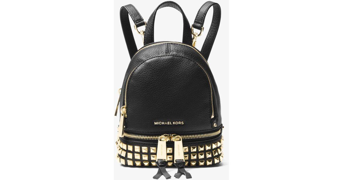 70d9cd8e6793 Lyst - MICHAEL Michael Kors Rhea Mini Studded Leather Backpack in Black