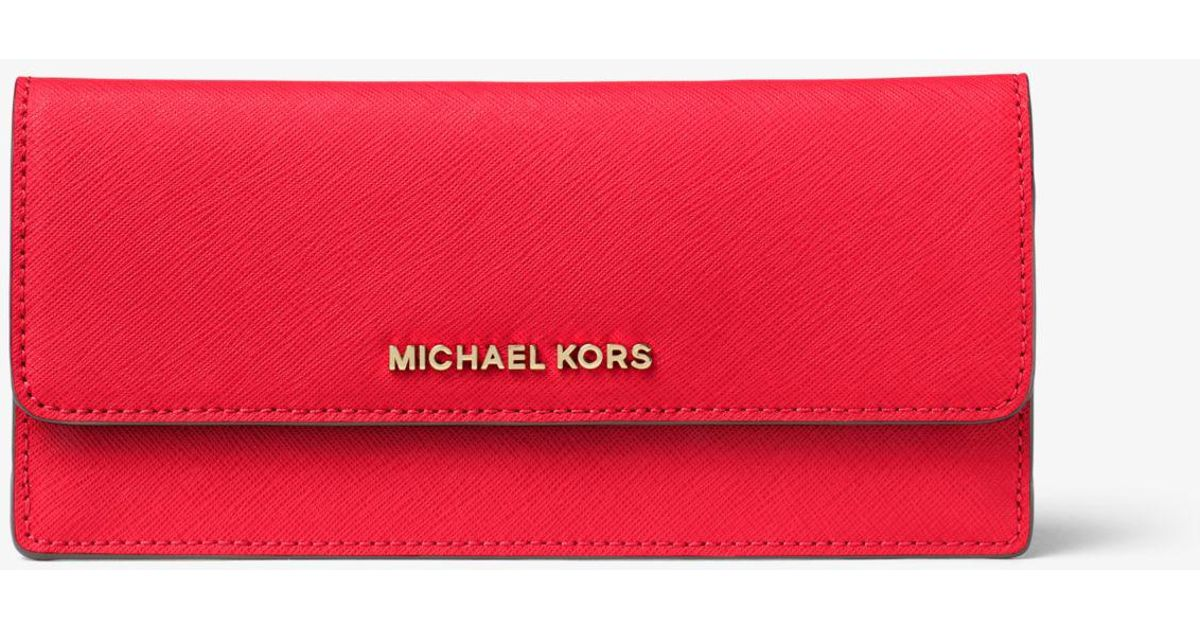 b824e14ef988 Lyst - Michael Kors Travel Slim Saffiano Leather Wallet in Red