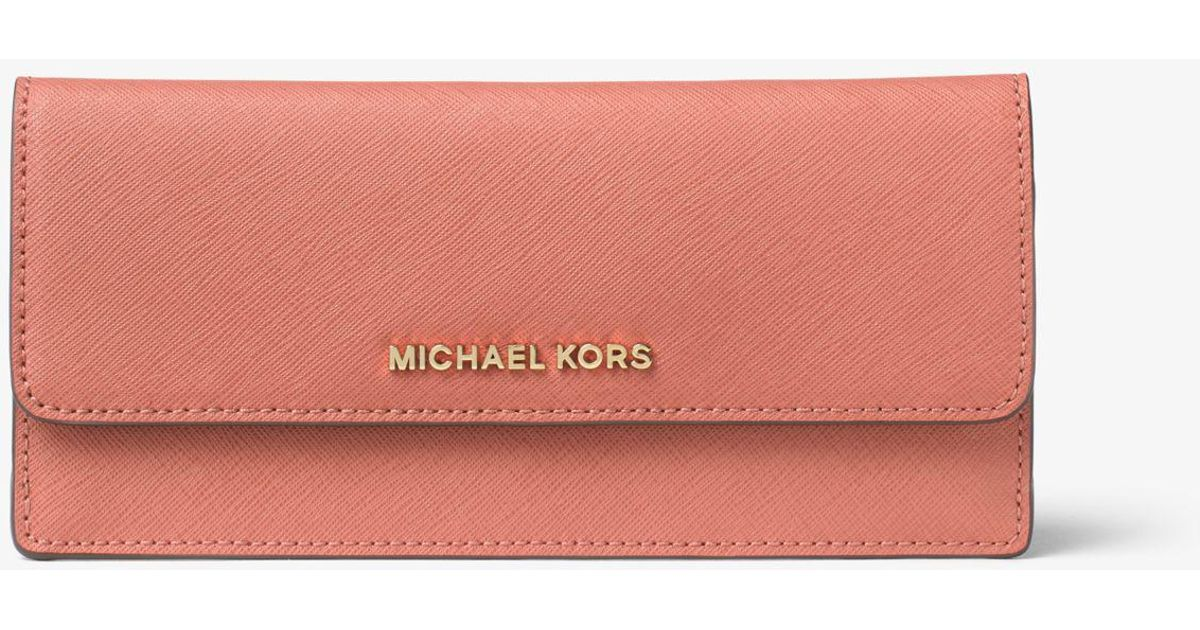 32d86000ad538e ... where can i buy lyst michael kors jet set travel slim saffiano leather  wallet in pink