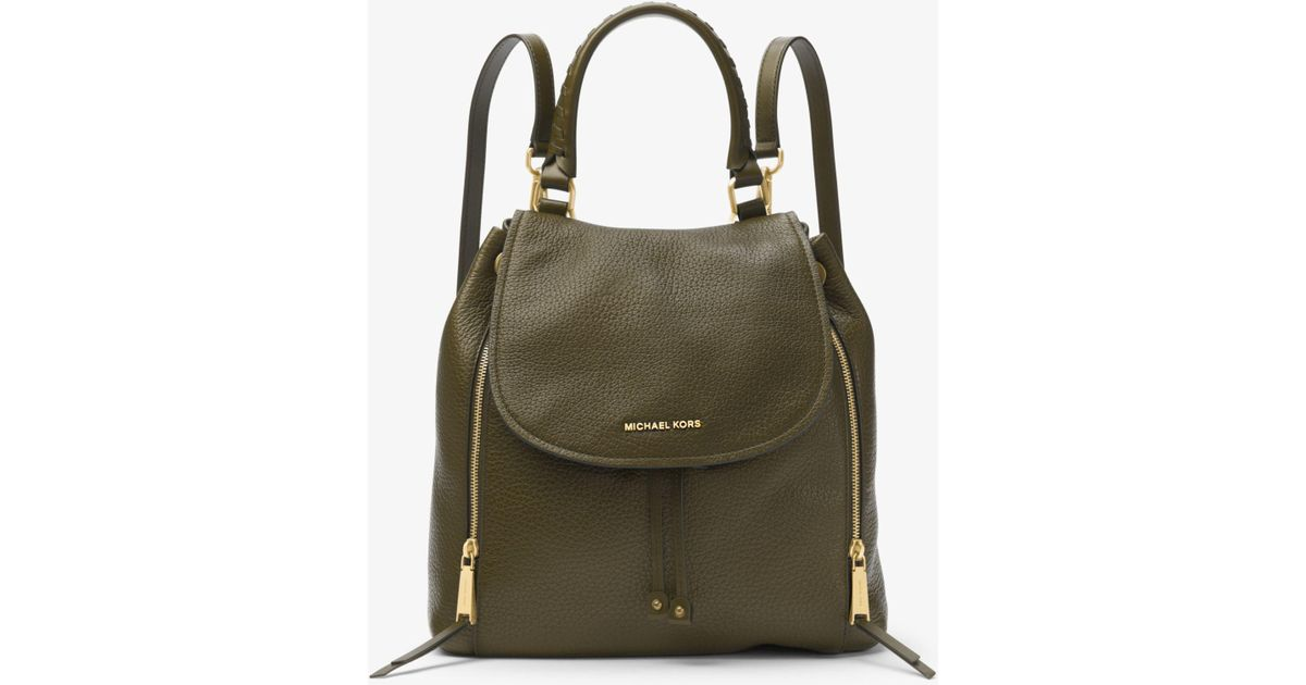 b75595b69f7e ... where to buy lyst michael kors viv large leather backpack in green  c4b12 544c1