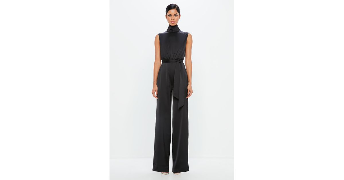 8d4150e11ad6 Lyst - Missguided Peace + Love Black Satin High Neck Belted Jumpsuit in  Black