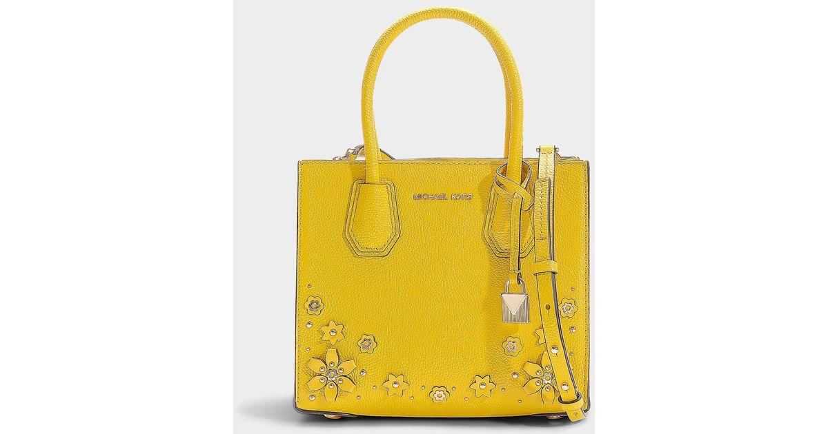 87ecc261ff54 MICHAEL Michael Kors Mercer Medium Messenger Bag In Sunflower Calfskin With  Flower Embellishments in Yellow - Lyst