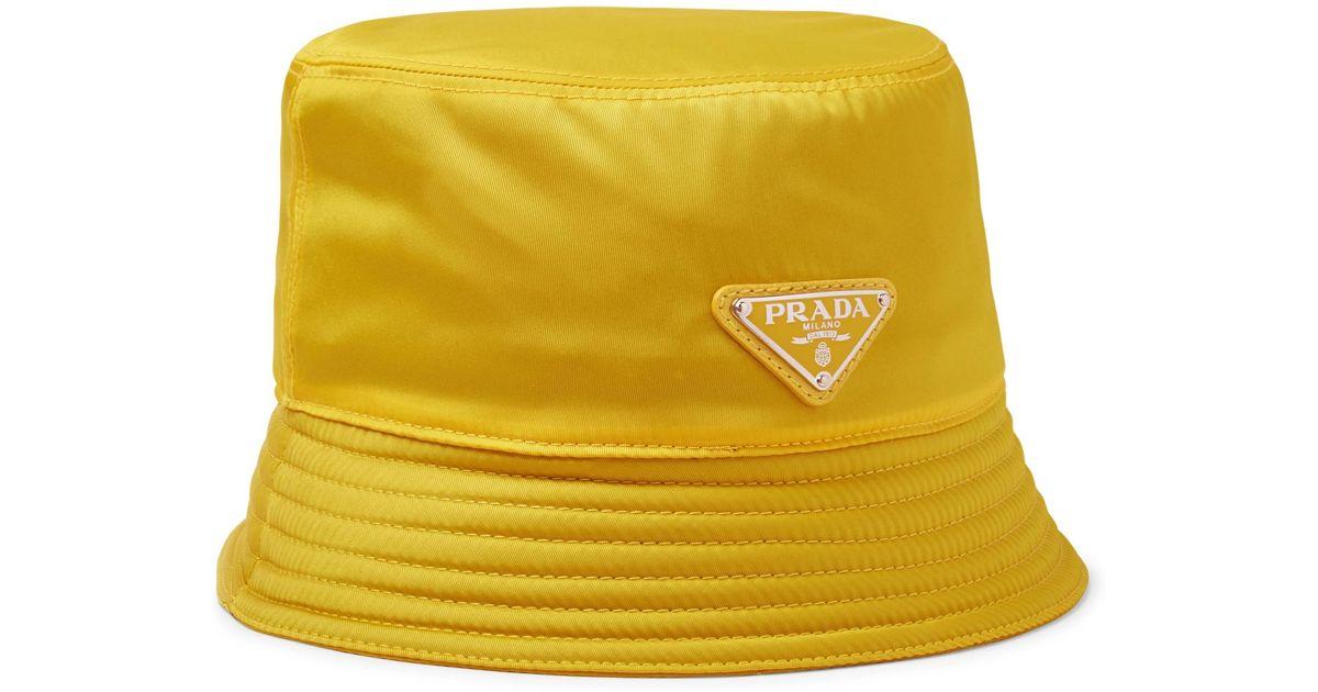 Lyst - Prada Logo-appliquéd Nylon Bucket Hat in Yellow for Men b4a6925a38f