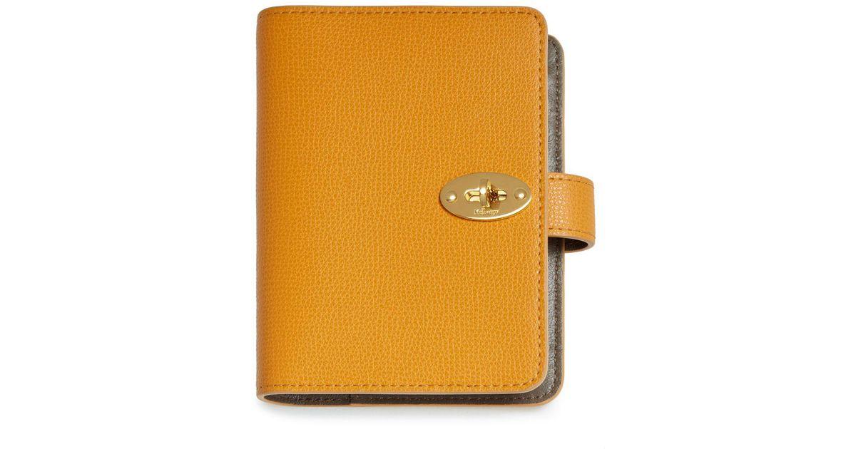 8e565133329 Mulberry Postman's Lock Pocket Book In Deep Amber Cross Grain Leather in  Orange - Lyst