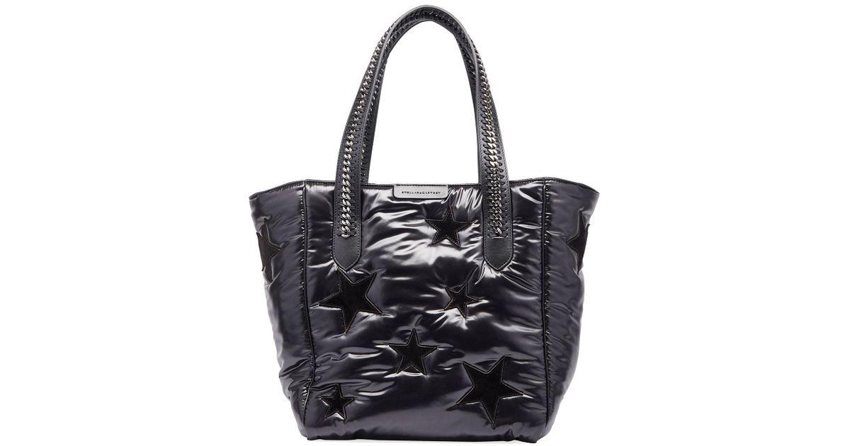 8ca77ca1674a Lyst - Stella McCartney All Over Stars Falabella Go Tote Bag in Black