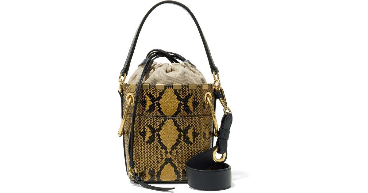 6f6535f0257f8 Lyst - Chloé Roy Mini Snake-effect Leather Bucket Bag