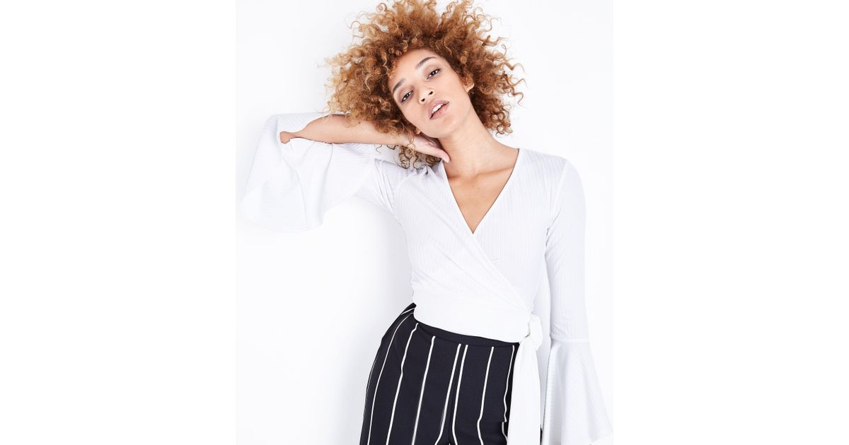 5f612e41a89 New Look Off White Ribbed Bell Sleeve Wrap Top in White - Lyst