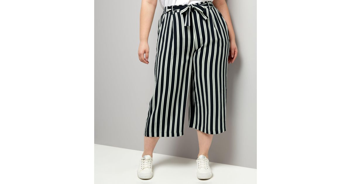 4ad76d11d7 New Look Curves Navy Stripe Tie Waist Wide Leg Cropped Trousers in Blue -  Lyst
