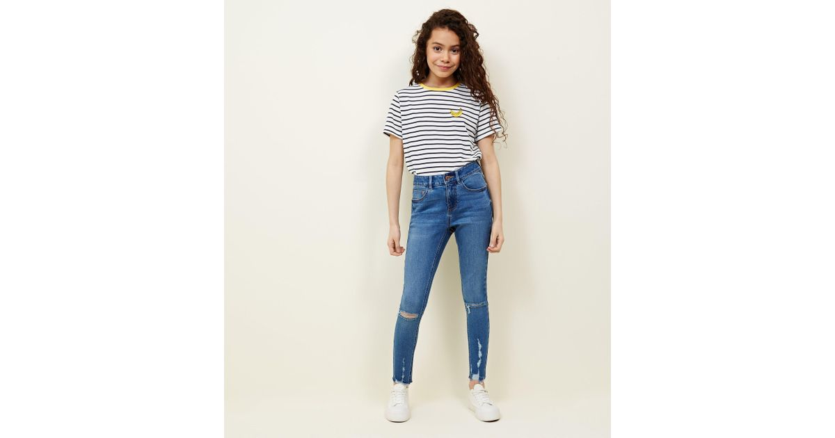 2ee256583412 New Look Teens Blue Light Wash Ripped Skinny Jeans in Blue - Lyst