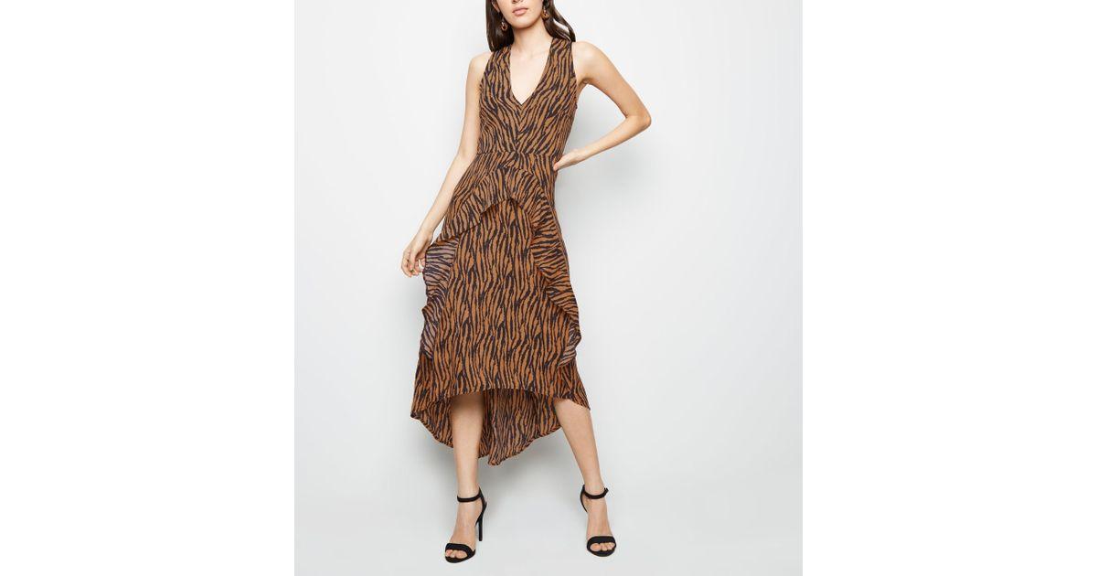Ax Paris Brown Tiger Print Dip Hem Midi Dress in Brown - Lyst efc26ee51