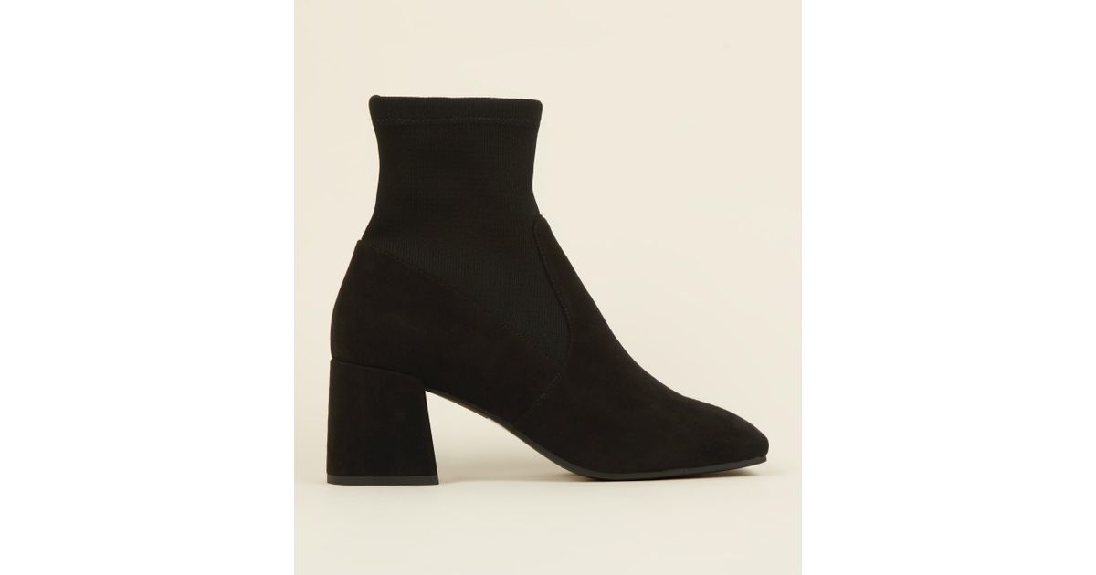 482a5be071b New Look Black Suedette Flared Block Heel Sock Boots in Black - Lyst