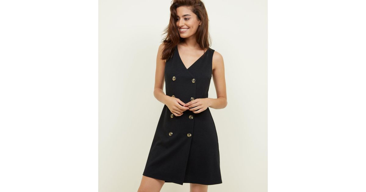 1b47dba8a9f New Look Black V Neck Double Breasted Pinafore Dress in Black - Lyst