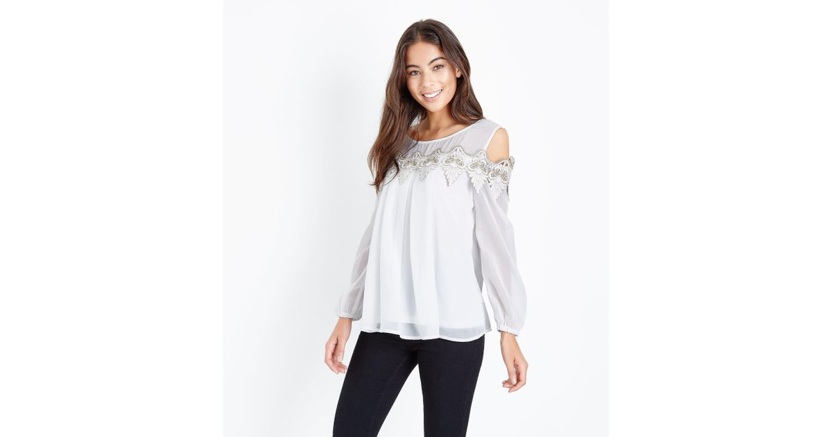 8c56c9460b2803 Mela White Lace Trim Cold Shoulder Top in White - Lyst
